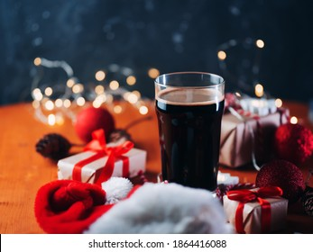 Christmas glass of dark strong ale, stout or porter on a festive decorated table