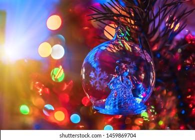 Christmas glass toy angel for Christmas tree closeup. Christmas colorful background. Christmas tree. Festive lights