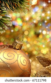 Christmas glitter ball and fir branch as christmas decoration.