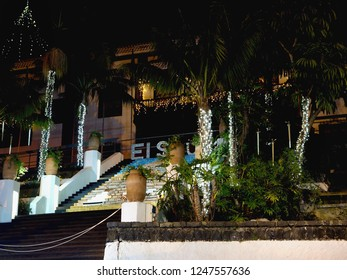 """Christmas glittering in """"El Sauzal on Tenerife"""". Fairy lights and dripping pearls at Christmas time and under flowering trees and palms."""