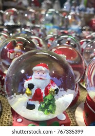 Christmas globe with Santa Claus in market kiosk