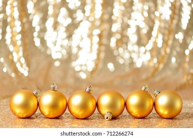 Christmas gold balls in winter setting,Winter holidays concept. Holiday frame