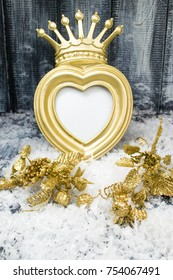 Christmas gold crown frame on gray wooden background