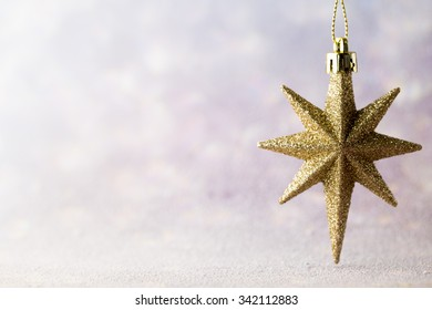 Christmas gold decoration over wooden background.