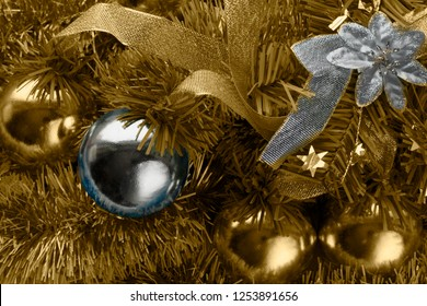 Christmas golden background with silver ball and flower, toned. Flashback
