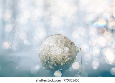 Christmas golden ball on bokeh background