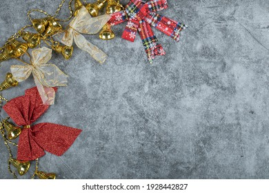 Christmas golden bells and ribbons on marble background