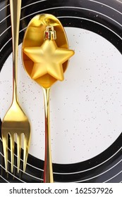 Christmas golden cutlery on a plate