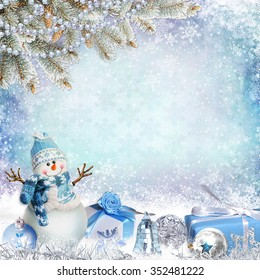Christmas greeting background with pine branches, snowman and gifts