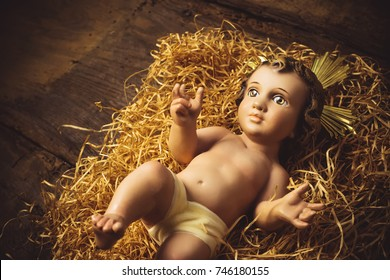 Christmas greeting card, Baby Jesus vintage figurine in his crib.