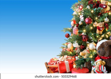 Christmas greeting card with decorated Christmas tree. Blue and white background. Space for text on left side.