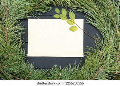 Christmas Greeting Card. Fir Branch And Decoration On Plank. Christmas Fir Tree On Wooden Background with Letter. Copy Space