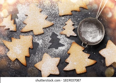 Christmas greeting card with fir tree gingerbread cookies on stone background. Top view flat lay