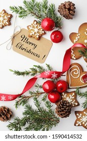 christmas greeting card with gingerbreads and christmas ornaments