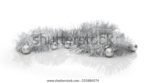 Christmas greeting card made of silver tinsel with silver christmas balls, copy space