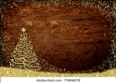 Christmas greeting card rustic style. Gold Christmas tree freehand drawing whith golden glitter on old wooden table with copy space for message or photos.