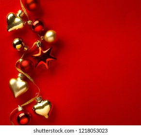 Christmas greeting card  or seasonal banner background; christmas tree decoration on red background