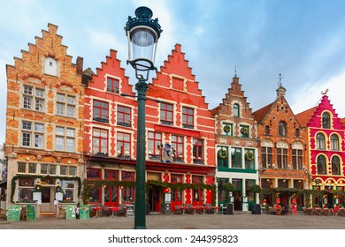 Christmas Grote Markt square in the beautiful medieval city Brugge at morning, Belgium.