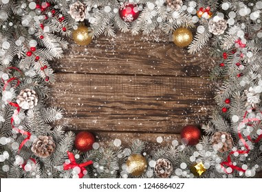 Christmas grunge wooden background with snow fir tree. View with copy space