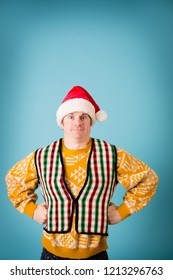 Christmas Guy Posing in Ugly Sweaters and Santa Hat, Room for Text Above
