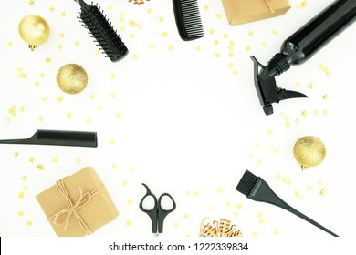 Christmas hairdresser frame composition with spray, combs, scissors and gift box with balls on white background. Flat lay, top view