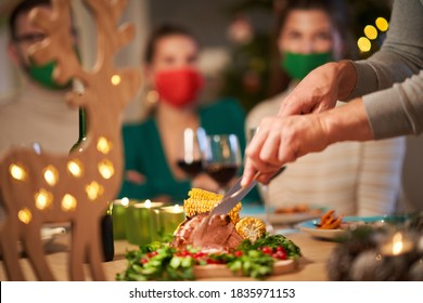 Christmas ham being served on the table - Shutterstock ID 1835971153