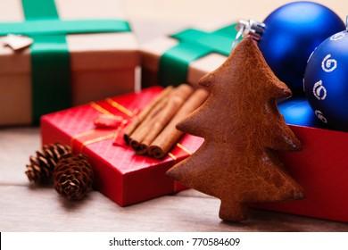 Christmas handmade cookie of fir tree shape, gift boxes, spice and christmas balls