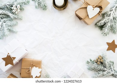 Christmas handmade gift boxes on white crumpled background top view. Merry Christmas greeting card, frame. Winter xmas holiday theme. Happy New Year. Noel. Flat lay