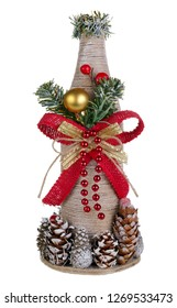 Christmas handmade tree made of bottle rope and cones in rural style. Isolated on white studio macro
