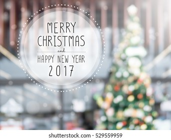 Christmas and Happy new year 2017 on blurred bokeh christmas tree background