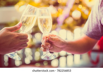 Christmas and Happy new year anniversary party holiday with smash toast sparkler wine in beautiful champagne glasses and christmas tree as background