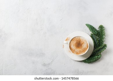 Christmas and happy new year card with cup of coffe, pine, fir and gingerbread on white background, copy space, top view