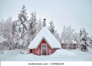 Christmas and happy New Year concept. Christmas hut and snowy trees in the winter forest. Great festive mood, place for text. Lapland, Finland, Europe. - Shutterstock ID 1749826196