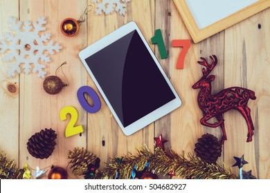 Christmas and Happy new year decoration flat lay on wooden board background, festival concept
