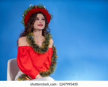 Christmas Happy Woman in blue bacground, happy new year woman with red dress, happy woman with red dress celebrities, woman celebrating new year