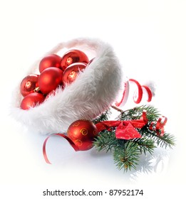 Christmas hat with balls isolated on white
