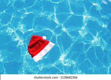 Christmas hat floating on swimming pool water