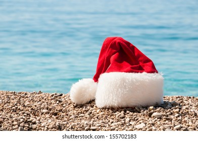Christmas hat lies on the beach.