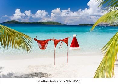 christmas hat and red bikini on tropical beach