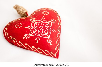 Christmas heart on white background and space for text.