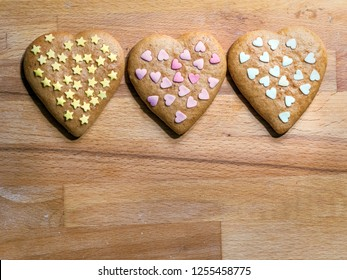 christmas Heart-shaped gingerbread cookies with stars and heart decoration placed on wooden board