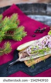 Christmas herring with red onion, dill and ground black pepper