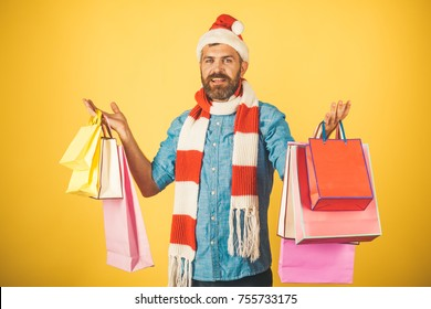 6ace78df1d9b5 Christmas hipster shopper wear santa hat and scarf. Black friday sale  concept. Man hold