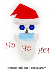 Christmas Ho Ho Ho greeting card. Santa Claus face made of Christmas toys, fir tree, beard in a medical protective mask with Santa's mittens on white background. Christmas symbol. Creative. Flat lay.