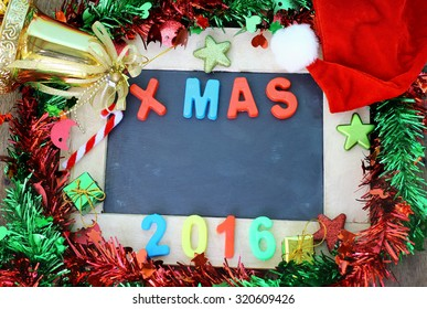 Christmas holiday background with chalk board and decoration