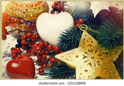 Christmas Holiday Background decorated with baubles, star and heart