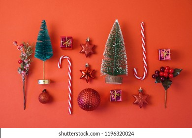 Christmas holiday background with decorations and ornaments on red table. Top view from above. Flat lay