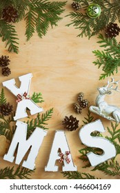 Christmas holiday background with empty space for a greeting text, flat lay, view from above, stylized photo, vertical orientation