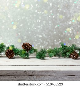 Christmas holiday background with empty wooden white table and christmas lights