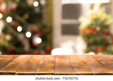 Christmas holiday background with empty wooden table top over festive bokeh light decorate on tree. For create montage product display